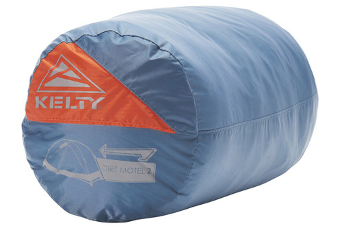 Kelty Dirt Motel 2 person tent packed inside blue cylinder-shaped storage bag