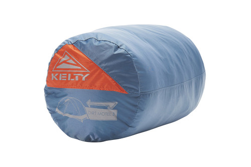 Kelty Dirt Motel 3 person tent packed inside blue cylinder-shaped storage bag