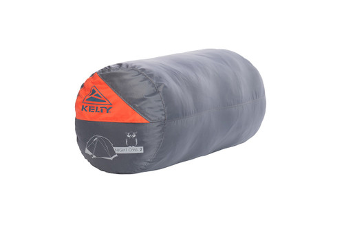 Kelty Night Owl 2 person tent, packed in grey cylinder-shaped storage bag
