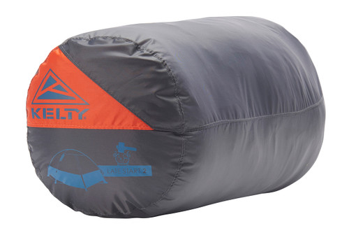Kelty Late Start 2 person tent packed inside gray cylinder-shaped storage bag