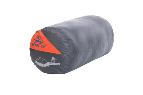 Kelty Late Start 4 person tent packed inside gray cylinder-shaped storage bag