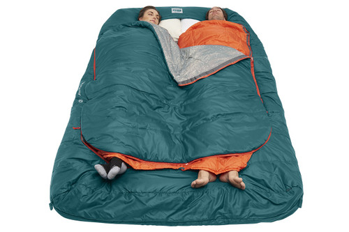 Couple sleeping in Kelty Tru.Comfort Doublewide 20 with bag partially unzipped at top and bottom, and feet exposed