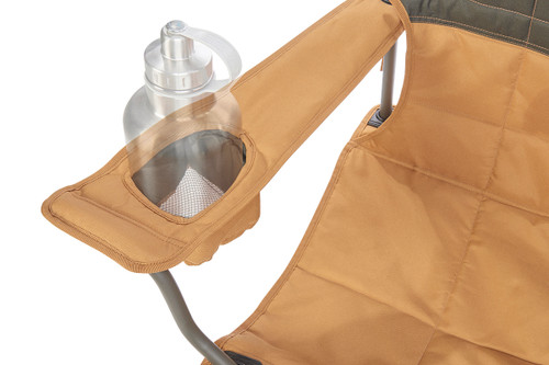 Close up of Kelty Essential Chair, Canyon Brown, showing large water bottle in armrest pocket
