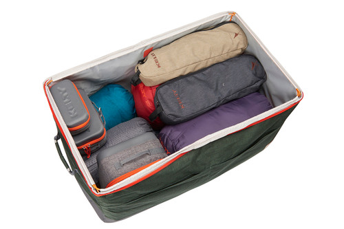 Kelty Big G storage bag, green colorway, opened, showing how it can hold multiple objects and containers