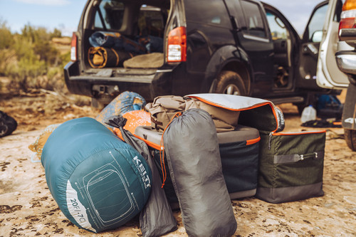 Kelty Big G storage bag, displayed next to other Kelty gear and a truck