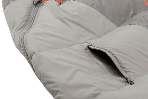 Close up of Kelty Cosmic 40 sleeping bag, showing small exterior zipper pocket