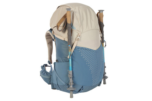 Kelty Women's Zyp 48 backpack, sand, with trekking poles attached to sides of pack
