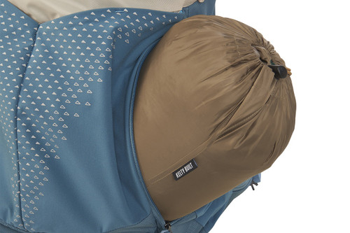 Close up of Kelty Women's Zyp 48 backpack, bottom unzipped and sleeping bag partially extending out of pack