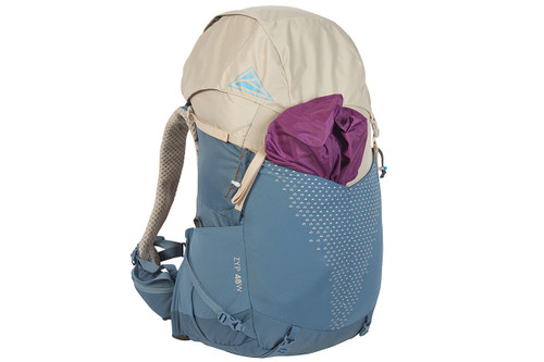 Kelty Women's Zyp 48 backpack, sand, with purple jacket stored in front pocket