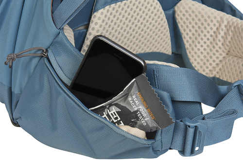 Close up of Kelty Women's Zyro 64 backpack waist belt, showing how phone and snacks can be stored inside waist belt pocket
