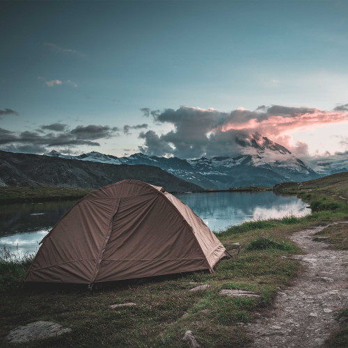 Kelty 1 Man Field Tent Import tent, shown in a beautiful mountain setting