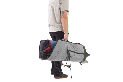 Man carrying Kelty Discovery High Cot inside storage tote