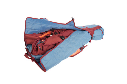 Kelty Discovery Low-Love 2-person chair, blue/red, packed inside storage tote, with tote partially unbuckled and opened