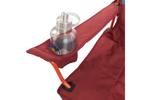 Close up of Kelty Discovery Lowdown chair, blue/red, showing large water bottle in armrest pocket