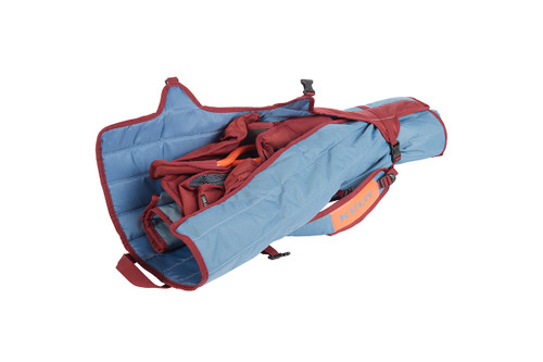 Kelty Discovery Lowdown chair, blue/red, packed inside storage tote, with tote partially unbuckled and opened