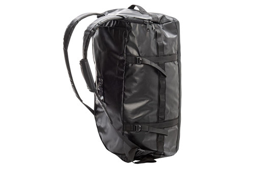 Kelty water resistant duffel, black, standing on its side, rear view showing padded backpack straps