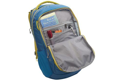 Kelty Flint 32 daypack, Lyons Blue/Warm Olive, opened to show interior organization pockets
