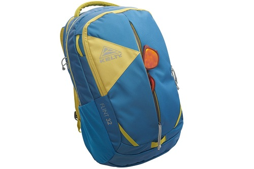 Kelty Flint 32 daypack, Lyons Blue/Warm Olive, with sunglasses partially extending from front external pocket