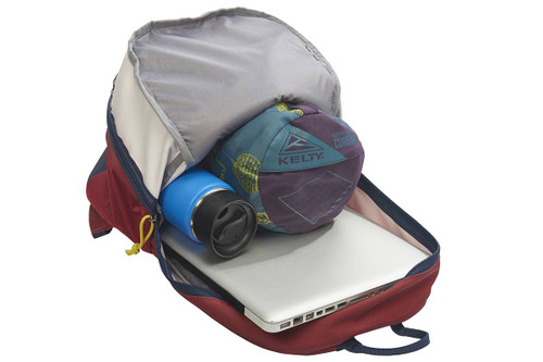 Kelty Quartz 33 Daypack, Red Ochre/Midnight Navy, opened to show blanket and water bottle stored in main compartment