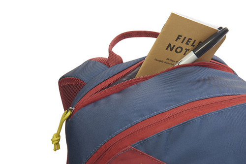 Kelty Geode 22 Daypack, Midnight Navy/Red Ochre, showing notebook and pen partially extending from top pocket