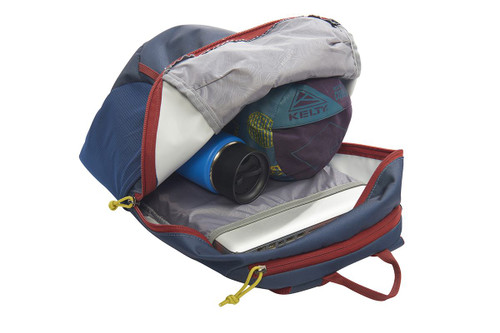 Kelty Geode 22 Daypack, Midnight Navy/Red Ochre,  opened to show blanket and water bottle stored in main compartment
