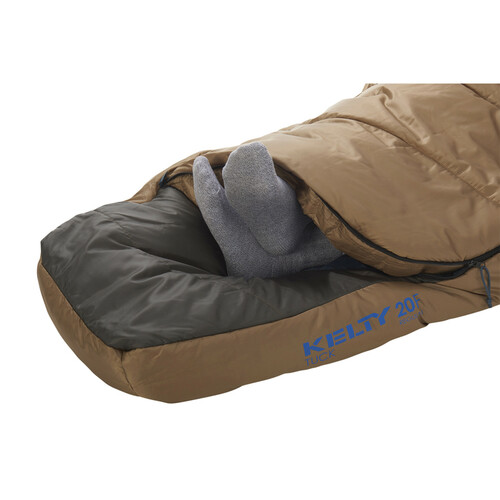 Close up of Kelty Tuck 20 sleeping bag, brown, showing how feet can extend out of the footbox opening