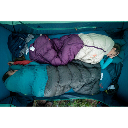 Overhead shot of couple sleeping in a tent with Kelty sleeping bags