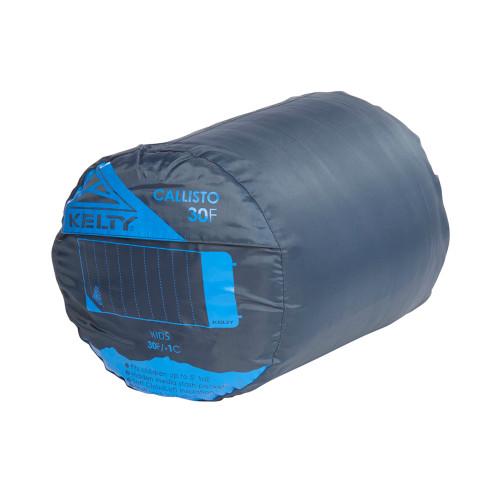 Kelty Kids Callisto 30 sleeping bag, Midnight Navy, shown packed inside stuff sack