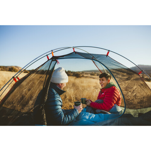 Couple enjoying their morning coffee in a Kelty tent