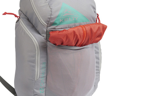 Close up of Kelty Redwing 22 backpack, with jacket stuffed into front pocket