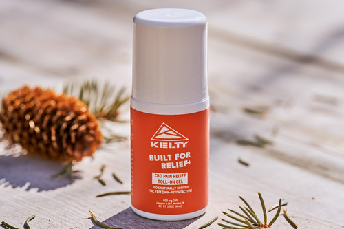 Kelty CBD Pain Relief Gel Roll-On, 200 mg, placed on a table