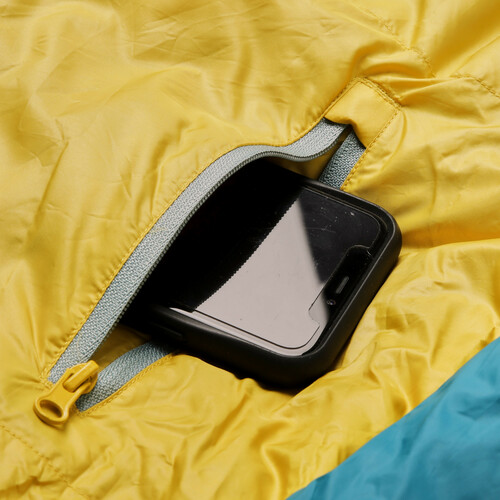 Close up of Kelty Women's Cosmic 20 Sleeping Bag, showing phone partially extending from small zipper pocket