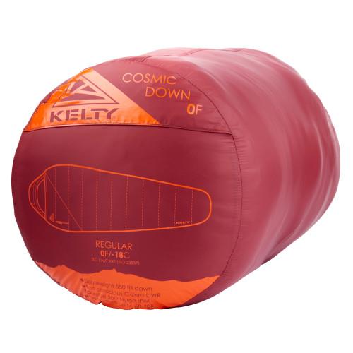 Kelty Cosmic 0 Sleeping Bag, red, shown stuffed inside sack