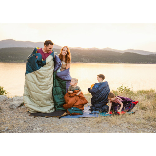 Family with Kelty Catena 30 Sleeping Bags on a beach