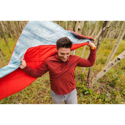 Man holding Kelty Bestie Blanket