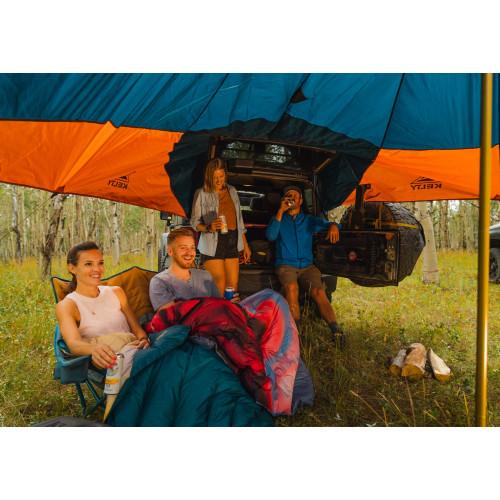 People gathered under a tarp