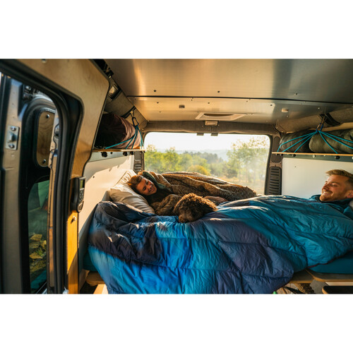 Friends in the back of a camper