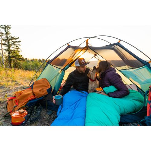 Couple in Kelty Cosmic Ultra 20 sleeping bags, inside tent