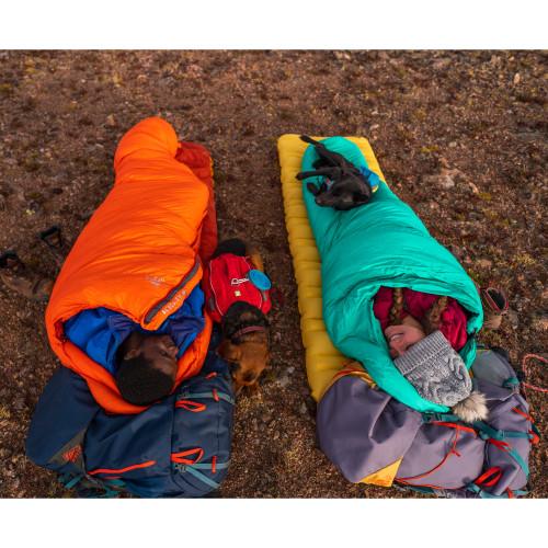 Couple sleeping in Kelty Cosmic Ultra sleeping bags, no tent