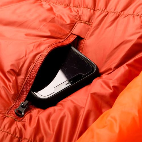 Close up of Kelty Cosmic Ultra 0 sleeping bag, showing phone in storage pocket