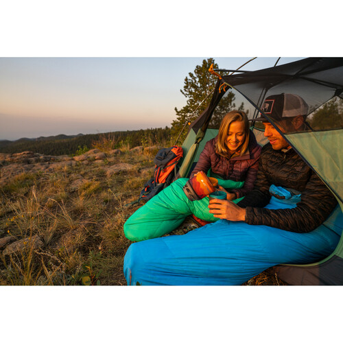 Couple in Kelty Cosmic Ultra 20 sleeping bags, in their tent