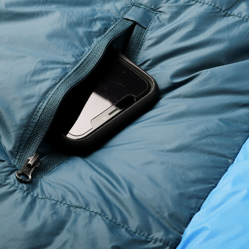 Close up of Kelty Cosmic Ultra 20 sleeping bag, showing phone in zippered pocket