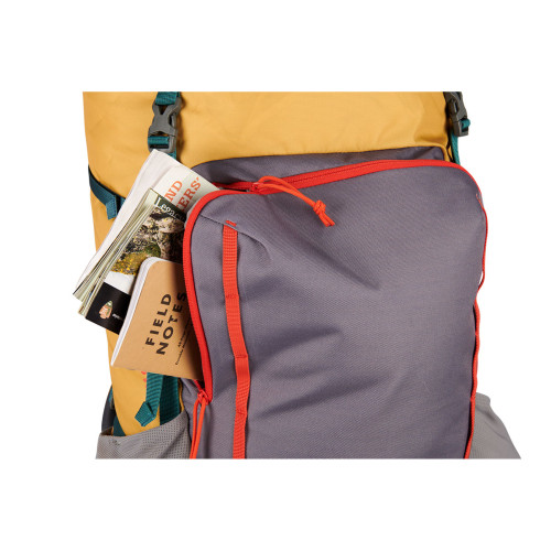 Close up of Kelty Women's Asher 55 backpack, showing items in front compartment