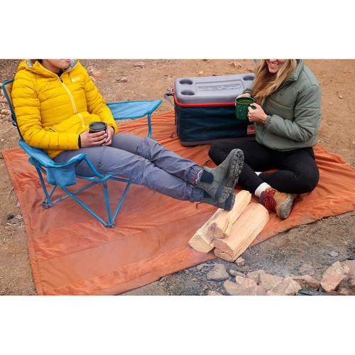 Two women sitting on the Kelty Cordavan Blanket