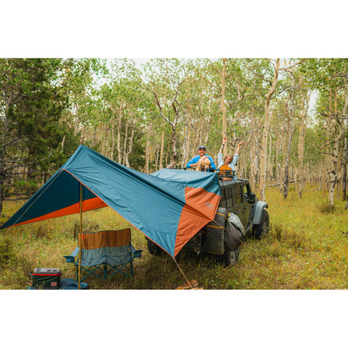 Kelty Waypoint Tarp, shown attached to Jeep at a campground