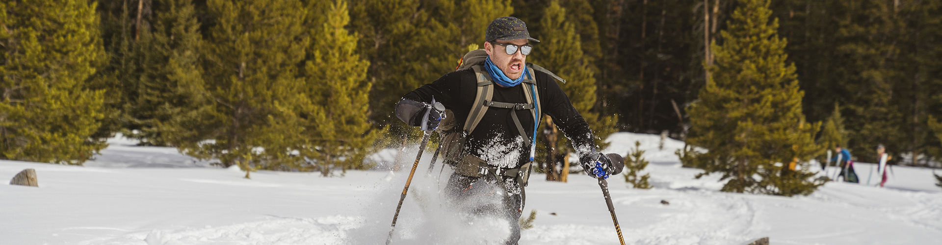 Man snowshoeing with Kelty trekking poles