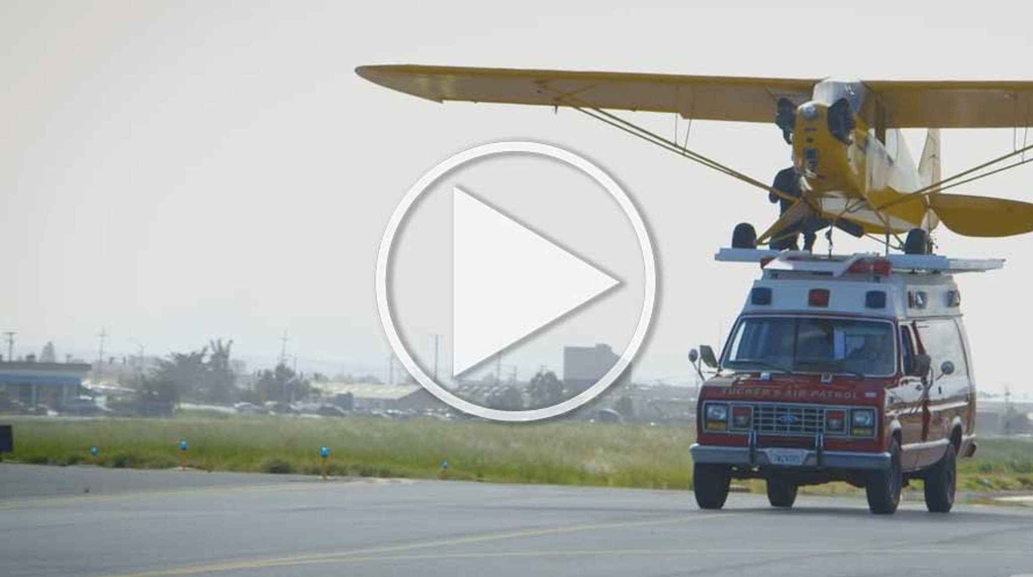 Wow! J-3 Piper Cub Lands On A Moving Ambulance
