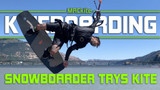 Snowboarder trys kite