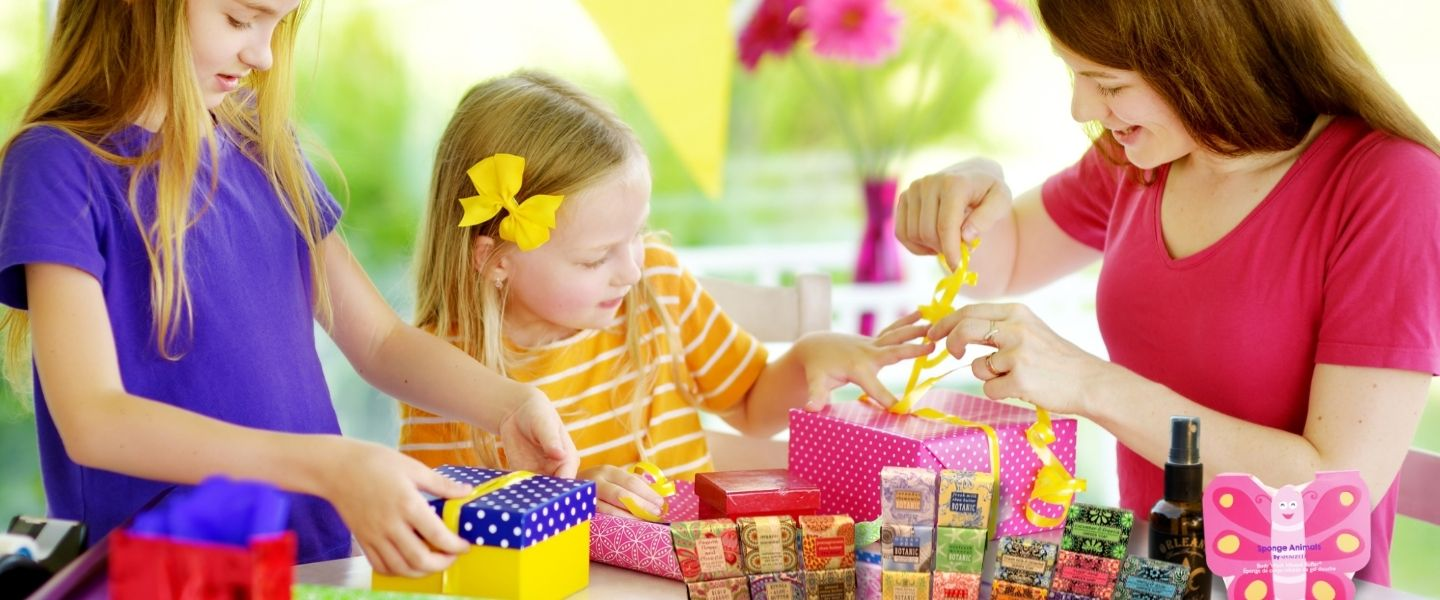 Kids wrapping Orleans Room Spray, Spongelle Animals, and decorative soaps