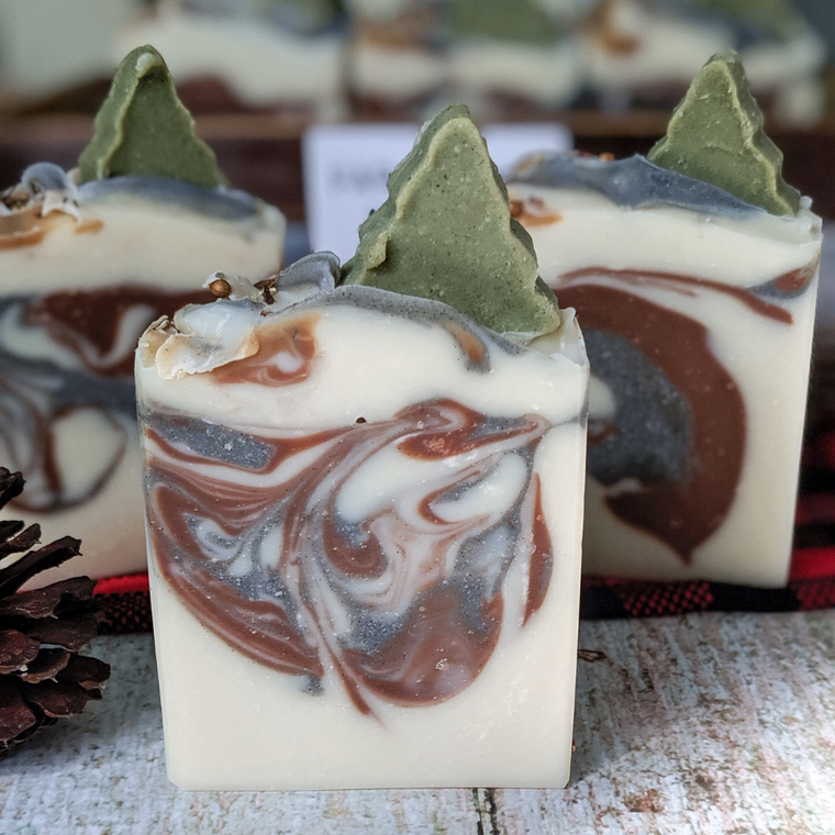 Cedar + Fir is naturally colored with cocoa powder, kaolin clay and activated charcoal.  The soap tree topper is colored with spirulina and chlorella.